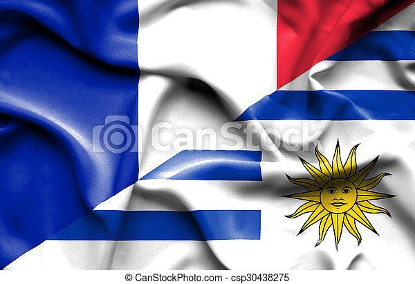 Waving flag of Uruguay and France - csp30438275