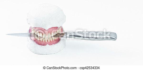 wax denture wth a knife - csp42534334