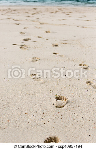 Way of human footprints on the beach sand - csp40957194