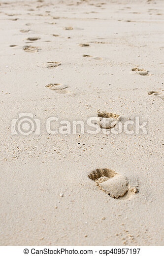 Way of human footprints on the beach sand - csp40957197