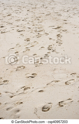 Way of human footprints on the beach sand - csp40957203