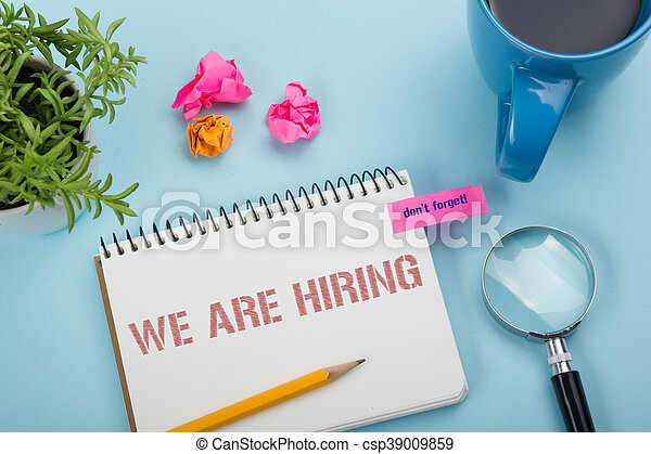 We are Hiring. Office desk table with notepad, pencil and coffee cup. Top view. - csp39009859