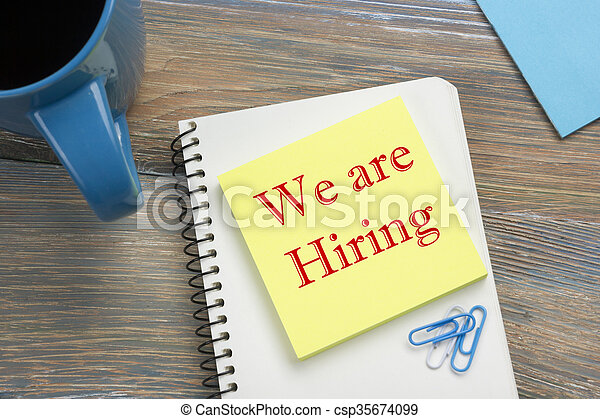 We are Hiring. Office desk table with notepad, reminder and coffee cup. Top view.  - csp35674099
