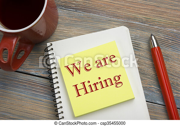 We are Hiring. Office desk table with notepad, pencil and coffee cup. Top view.  - csp35455000