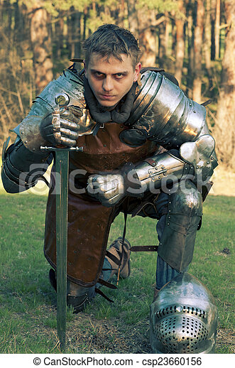 Weary knight stands on a glade - csp23660156