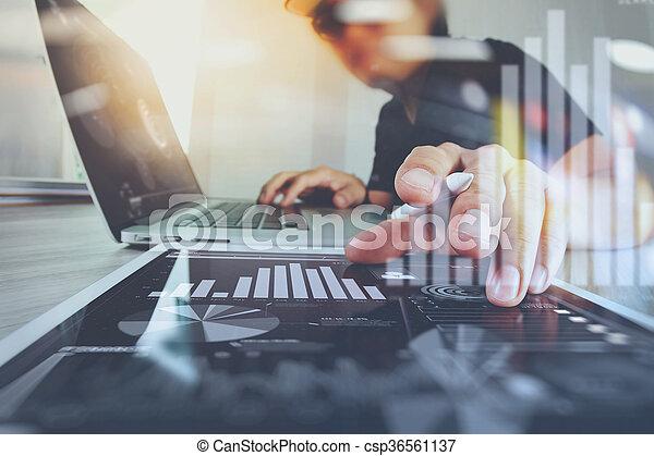 Website designer working digital tablet and computer laptop and digital design diagram on wooden desk as concept - csp36561137