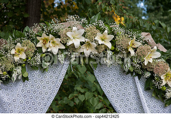 Wedding Arch Decorated With White Flowers Lilies In A Summer Park