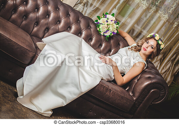 Wedding bouquet hotel room sofa - csp33680016
