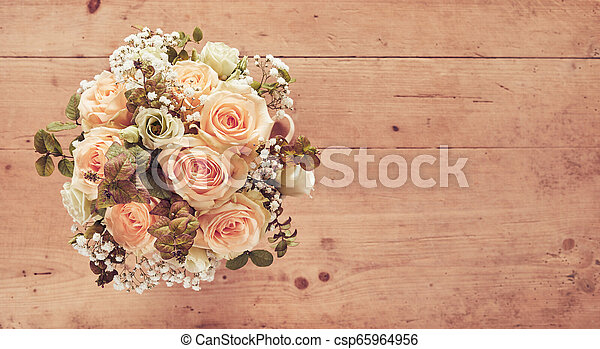 Wedding bouquet of pink roses on wooden background - csp65964956