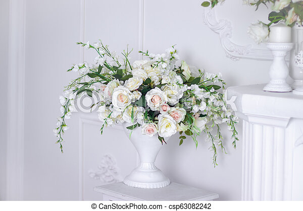 Wedding bouquet of white roses in a vase. Wedding decorations. White Rose.