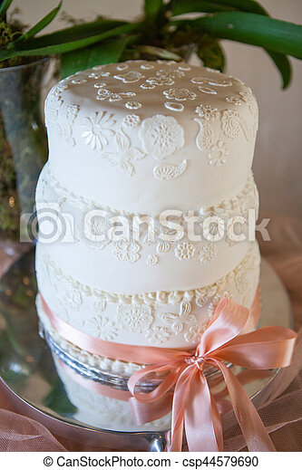 Wedding cake decorated with white icing - csp44579690