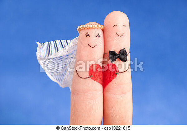 wedding concept -  newlyweds painted at fingers against blue sky, good use for wedding invitation card - csp13221615