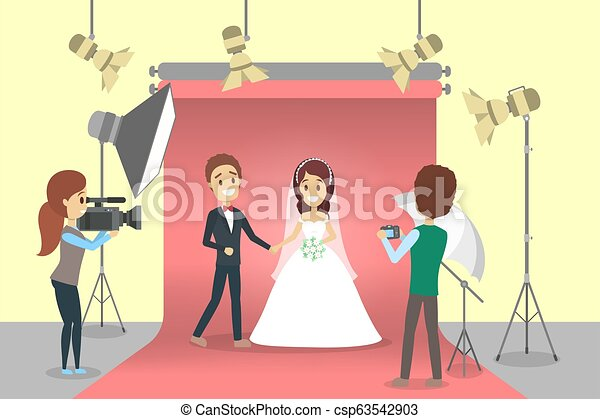 Wedding couple in the photostudio making photoshoot - csp63542903