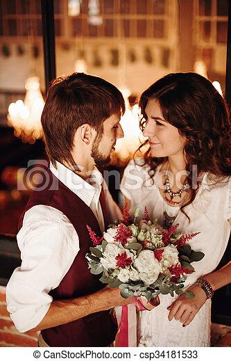 Wedding Couple Kissing in Loft Interior - csp34181533