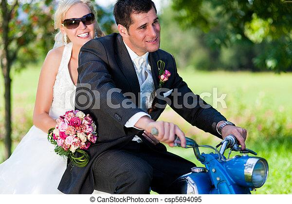 Wedding couple on a motorbike - csp5694095