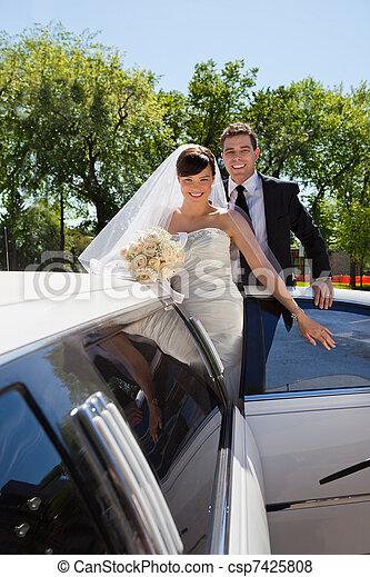 Wedding Couple with Limousine - csp7425808