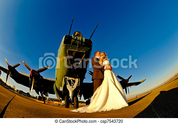 wedding couple with warplane - csp7543720