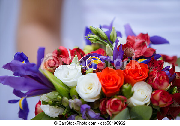 wedding decorative bouquet of rose with two golden rings - csp50490962