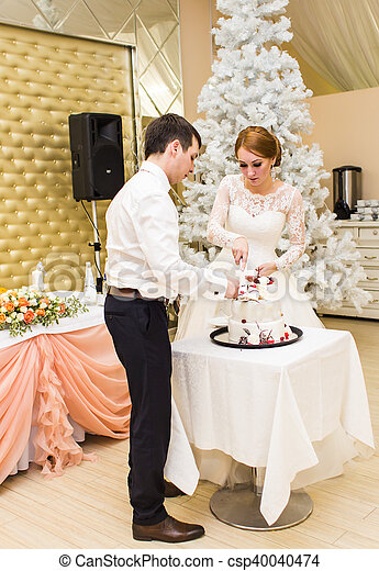 A Christmas Bride.Wedding In Christmas Bride And Groom Eating Cake At Reception