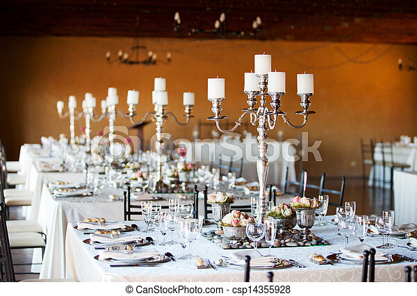 Wedding reception hall with decorated tables - csp14355928