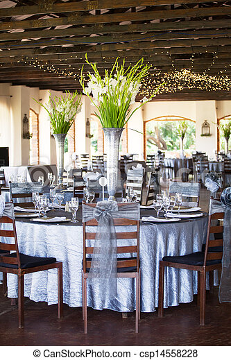 Wedding reception hall with gorgeous flower bouquets - csp14558228
