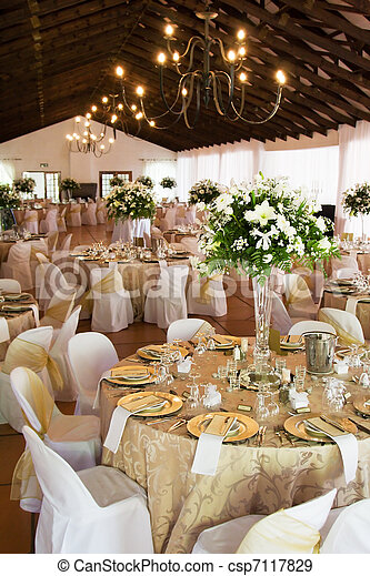 Wedding reception hall with laid tables - csp7117829