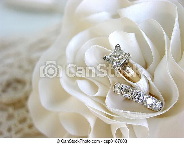 Wedding ring background Diamond wedding rings in the folds stock