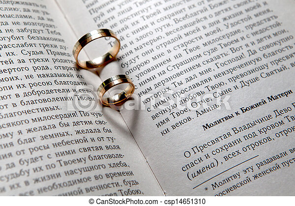 Wedding rings in bible Wedding rings with shadows like stock