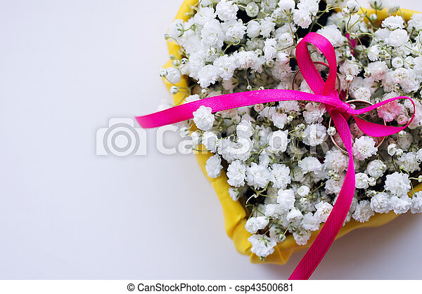 Wedding rings on a bed of flowers - csp43500681