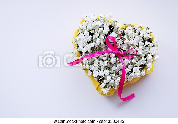 Wedding rings on a bed of flowers - csp43500435