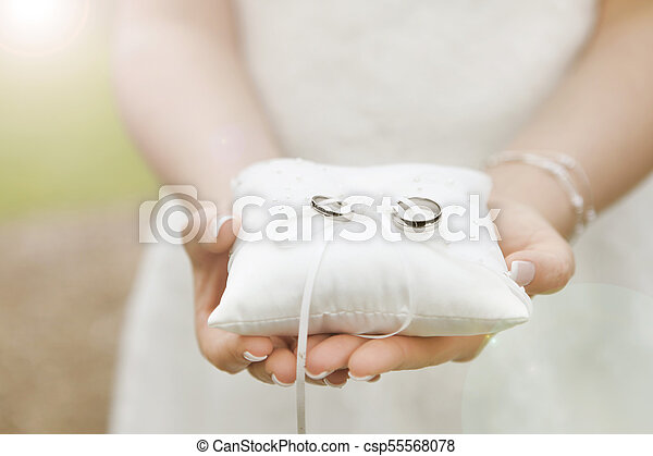 Wedding Rings On Ring Pillow A Bride Holds A Ring Pillow With The
