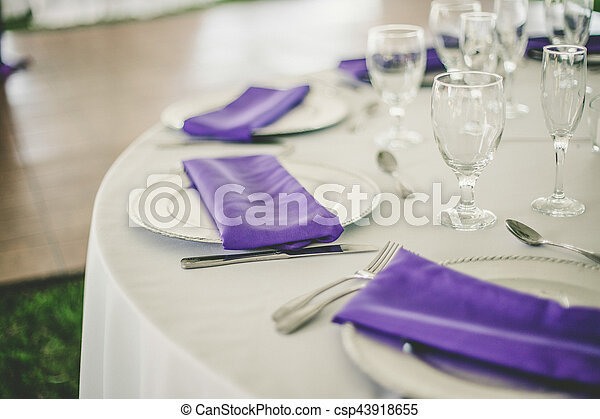Wedding table setup. Wedding reception table set up in purple and white.