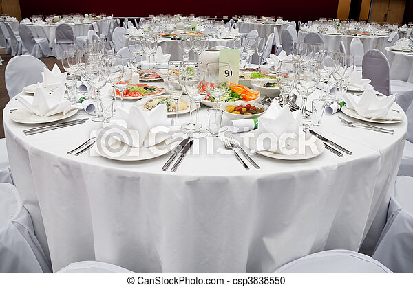 Wedding white reception place ready for guests. Elegant banquet tables prepared for a conference or a party. - csp3838550