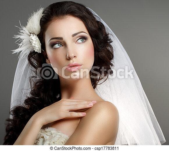 Wedding. Young Gentle Quiet Bride in Classic White Veil Looking Away - csp17783811