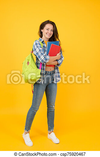 Welcome school. Pretty student back to school. Happy woman ready for school yellow background. September 1. Education and knowledge. Private teaching. Schooling. School matters - csp75920467