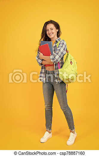 Welcome school. Pretty student back to school. Happy woman ready for school yellow background. September 1. Education and knowledge. Private teaching. Schooling. School matters - csp78887160