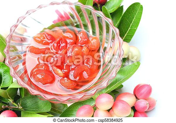 Welded carissa carandas fruits on white background - csp58384925