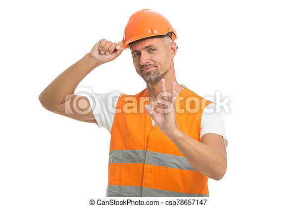 well done. excited electrician show ok gesture. handsome service worker isolated on white. asphalt worker at construction site. just perfect. positive man in helmet. plumber is water supply worker - csp78657147