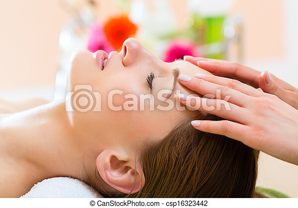 Wellness - woman getting head massage in Spa - csp16323442