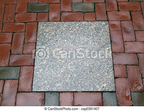 wet cement slab surrounded by bricks - csp0391407