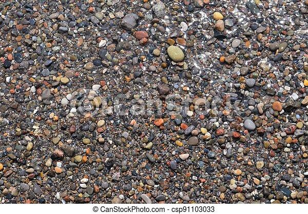 Wet pebbles - csp91103033