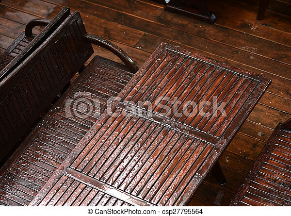 Wet table with chairs. Wet garden table with chairs after ...