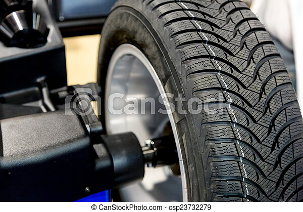 Wheel balancing close up - csp23732279