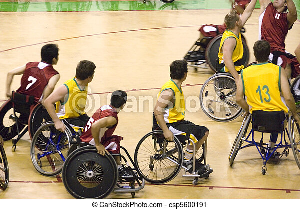 Wheel chair basketball players in action in an international tournament.
