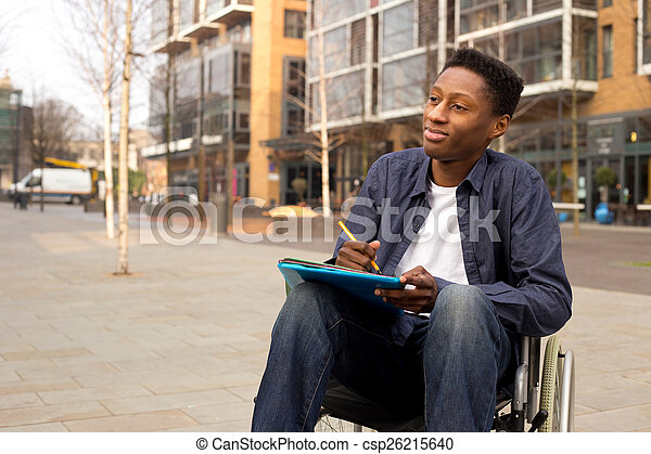 wheelchair bound man looking thoughtful with folders and a pen - csp26215640