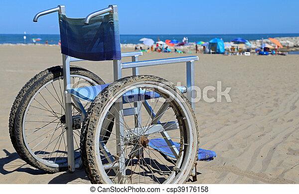 Wheelchair on the sandy beach - csp39176158