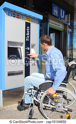 Wheelchair user on a ticket machine - csp19104650
