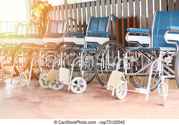 Wheelchairs in the hospital - Wheel chairs waiting for patient services disabled carriage - csp73122042