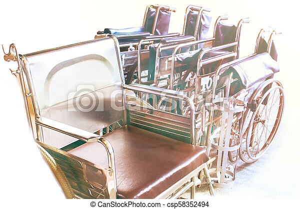Wheelchairs waiting for services. with sunlight copy space on area. - csp58352494