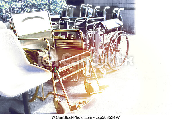 Wheelchairs waiting for services. with sunlight copy space on area. - csp58352497